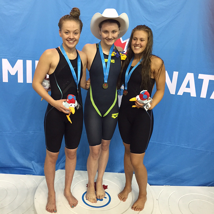 Maddy Broad, centre, has two golds to show for her efforts so far.