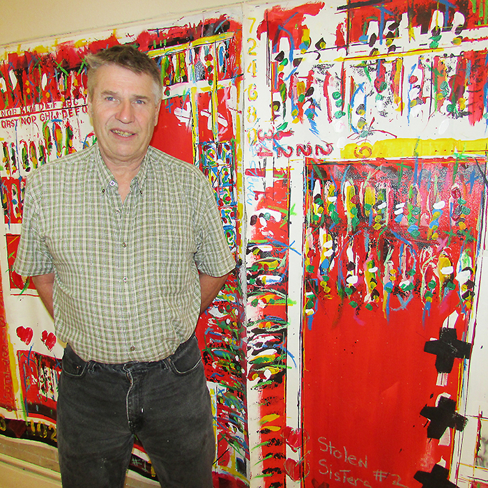 David Maris, artist and activist, stands with his art on canvas that he calls flags, and represents his anger over the governement's inaction on investigating the murdered and missing Indigenous women and girls in Canada, who he said are the most vulnerable. Maris is cautiously optimistic about the August announcement about launching a national inquiry into the issue.