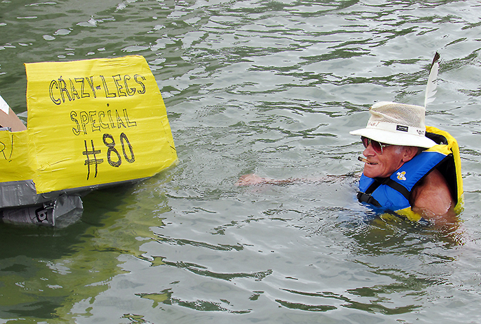 "Ken ""Crazy Legs"" Murphy was only a few feet away from finishing his lap at the WAMBO cardboard boat races Saturday when his ""Crazy Legs Special"" began taking on water and capsized. After wading ashore, his only comment was ""I should have named it 'The Titanic.'"""
