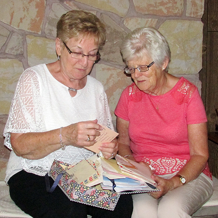 Shirley Perritt and Kathleen Morton look through some of the hundreds of letters the two have exchanged throughout their 65-years of being pen pals.