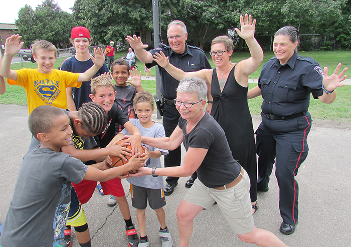 Members of the Chatham Central Neighbourhood Association including co-chair Karen Bondy, front, Jyl Panjer and Const. Amy Finn got help from CKPS Sgt. Jim Lynds taking on the neighbourhood kids at Wonderwood Park's new basketball nets Aug. 18.