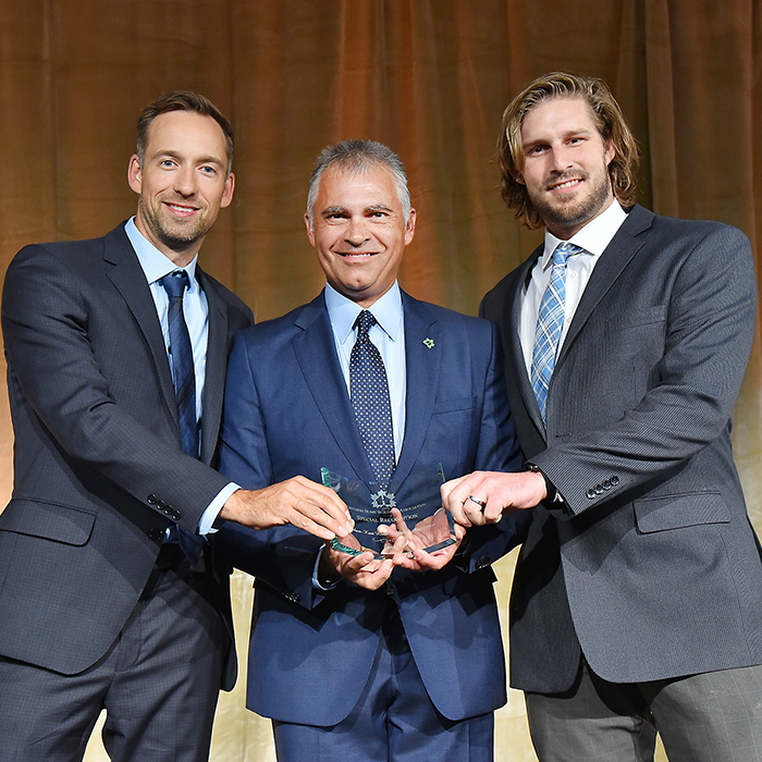 Chatham-Kent Home Builders Association officials Scott Vandersluis, left, and Kevin Owen, right, received the 2016 Ontario Home Builders Association Special Recognition Award for its 'Renovation for Evelynn' project from Ontario Home Builders Association President Neil Rodgers.