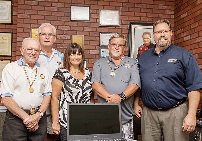 Chatham-Kent Crime Stoppers President Angie Shreve is shown here accepting the kit from Moose Lodge Govenor Bill Lyons, member Benny Turato, member Jerry Ytsma along with Crime Stoppers Coordinator David Bakker.
