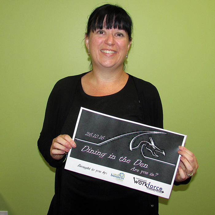Kristy Jacobs holds a poster for the coming Dragon's Den style celebration of small business to be held October 26 at the Chilled Cork. The winner of the competition will receive $5,000.