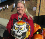 Plenty of people in Chatham-Kent have an artistic talent when it comes to carving pumpkins, donating their final masterpieces to the Chatham-Kent Women's Centre for a United Way fundraiser. Centre Executive Director Karen Hunter shows off one of the scarier of the 76 pumpkins donated by the staff, board members and the community at large.