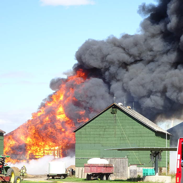 Firefighters from four stations battled a blaze on Erieau Road Sunday. Some $300,000 in property was destroyed while another $360,000 was saved. Photo courtesy Gail Lovell