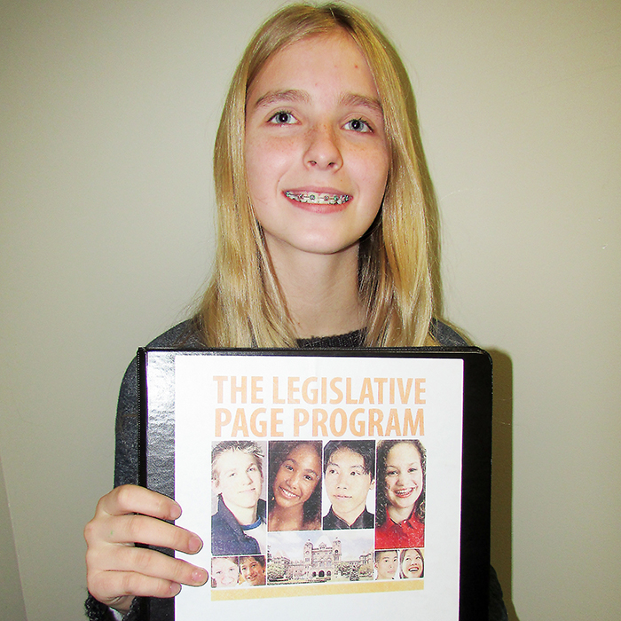 Victoria Armstrong, 13, studies names and faces of Ontario's Members of Provincial Parliament as she heads off to serve as a page for three weeks.