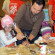 Amelia, 5, and Alexa, 3, try their hand at creating a craft, under the watchful eye of their dad, A.J. Kearney, at the 16th annual Chatham-Kent Toy Show & Sale Sunday at the John D. Bradley Convention Centre.