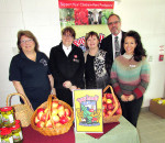 Cindy Parry, Outreach for Hunger, Capt. Stephanie Watkinson, Salvation Army, Alice Uher with the KFA and Uher Performance Feeds, Mary Anne Udvari, KFA, and Mayor Hope stand before a bountiful harvest of local fruits, vegetables and meat donated by area farmers in celebration of Food Freedom Day.
