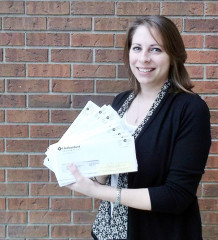 Amanda Bossy, accounts receivable supervisor with the municipality, shows some of the hundreds of interim tax bills that have been returned by Canada Post due to address issues.