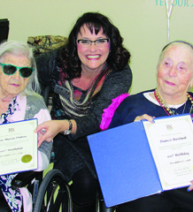 Anne Marie Rumble, centre, shown with two Meadow Park Nursing Home residents, said the province's long-term care homes need the public's help to pressure the province to improve funding for seniors' care.