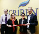 From left, Terry Johnson and Chandra Clarke, former vice-president and president respectively of Chatham-based Scribendi, have sold the business to new owners Patricia Riopel, president; and Enrico Magnani, CEO. The new owners are relocating to Chatham from Montreal.