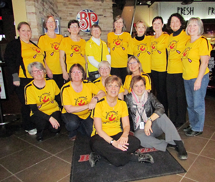 The Breast Buddies Dragon Boat Team recently held a fundraiser at Boston Pizza as the team gears up for international competition next year in Italy. With the team is Boston Pizza manager Mary Frances Kluka.