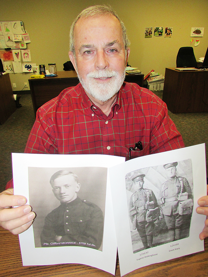 Local historian and curator of Gathering Our Heroes, Jerry Hind, holds pictures of First World War veterans he has found in his research.