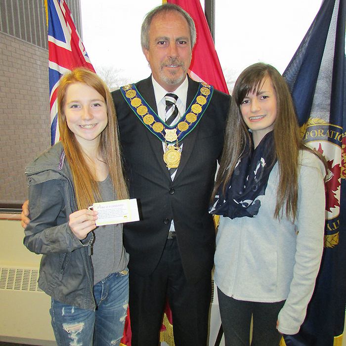Chatham-Kent Mayor Randy Hope met with St. Vincent Catholic School students Abby Bondy, left and Piper Phaneuf Monday, accepting a pay it forward challenge the duo came up with for their Kingdom Project at school.