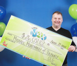 Tilbury's Mike Montminy is pictured here with his lottery win of more than $26 million through Lotto Max.