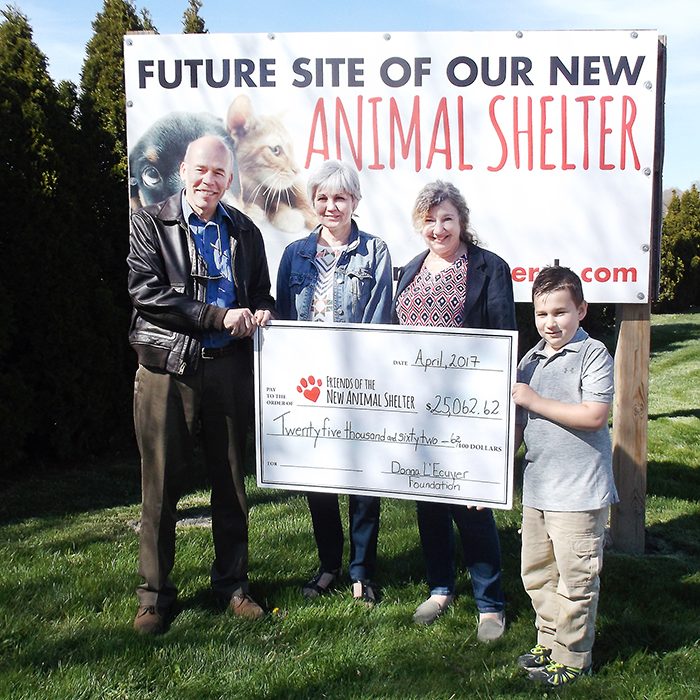 The new Chatham-Kent animal shelter is more than $25,000 closer to its goal thanks to a donation from the Donna L'Ecuyer Foundation. Here Friends of the new Animal Shelter committee member Dr. Bruce Warwick accepts a cheque from L'Ecuyer family members Cherie Metcalfe, Audrey L'Ecuyer and grandson Christos.