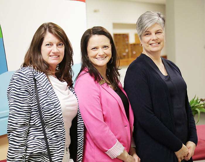 From left, Darlene Smith, Andrea Sullivan and Tania Sharpe are just three of 84 women who attended the recent Purses with a Purpose fundraiser.