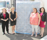 Sleep Country Canada, recently opened in north Chatham, donated beds and bedding to nine local families on April 27 as part of its community outreach mandate. From left are Shelley Wilkins, Chatham-Kent Director of Housing Services; Christine Magee, Sleep Country co-founder and executive co-chair; donation recipient Teresa Coleman; and Lynn Martel, Sleep Country vice-president of community programs.