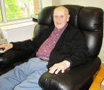 Ken Thompson relaxes in his room at St. Andrew's Residence. The avid shutterbug and retired farmer enjoys his time there, and never goes anywhere without his camera.