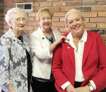 Pictured are past June Callwood award winners Kathleen Moderwell, left, and Lyn Rush presenting Jennifer Wilson with her June Callwood pin.