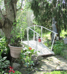 The gardens of Eric and Sherrie Piens in Chatham are part of the Zonta annual garden and pond tour, set for June 23 and 24. Pictured are the front and back gardens, before the annuals are even planted. Piens promises even more colour for the event.