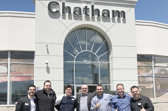 From left, KC Chaaban, Brian St. Pierre, Scott Bishop, Vince Lally, Adam Lally, Mike Hogue, and Matt Herder celebrate the recent sale of Chatham Chrysler to the Lally family.