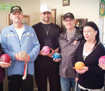 "The Chatham Lawn Bowling season is underway with a new program this year for visually impaired bowlers. Thanks to the Anjema Eye Institute, six sets of coloured bowls help the bowlers ""see."" Pictured on the right is Patricia Cap from Anjema Eye Institute with some of the visually impaired bowlers and their aides."