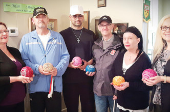 """The Chatham Lawn Bowling season is underway with a new program this year for visually impaired bowlers. Thanks to the Anjema Eye Institute, six sets of coloured bowls help the bowlers """"see."""" Pictured on the right is Patricia Cap from Anjema Eye Institute with some of the visually impaired bowlers and their aides."""