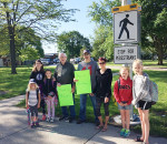 The students at Dresden Area Central School and the community thanked crossing guard Jim Cracknell and the businesses who made sure he was able to stay on the job until the new crosswalks were in place. Pictured are, from left, Addy McLean, Rebecca Pederson, Victoria Pederson, Jim Cracknell, Rob Burnett, Erin Burnett, and students Marissa McGee & Abby McGee.
