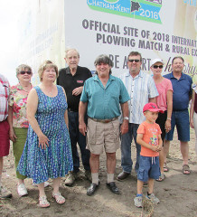 Host landowners on Pain Court Line for the 2018 International Plowing Match set for September of 2018 gathered at the unveiling of the sign marking the IPM site recently. Pictured from left are Clayton and Mary Ellen Crow, Lucille and Jean Marie Laprise, Gerard Faubert, Scott and Terry Pritchard with son Keegan, John Faubert, and Princess of the Furrow Brynn Depencier.
