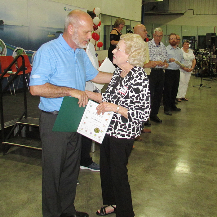 Local MP Dave Van Kesteren hands out a certificate of recognition to Mary McDonnell, who is nearly 96 years of age. Mary was one of the key people who started the Active Lifestyle Centre in Chatham in 1970.