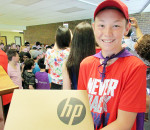 Indian Creek Public School student Braden St. Pierre, who was part of the winning Microsoft project, showcases one of the 28 HP Pro-G3 laptops that are a part of the winning prize pack given to the school.