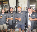 From left, Sons of Kent owners Colin Chrysler, Doug and Alf Hunter and Tim Copeland celebrate the official opening of their King Street West craft brewery Saturday.