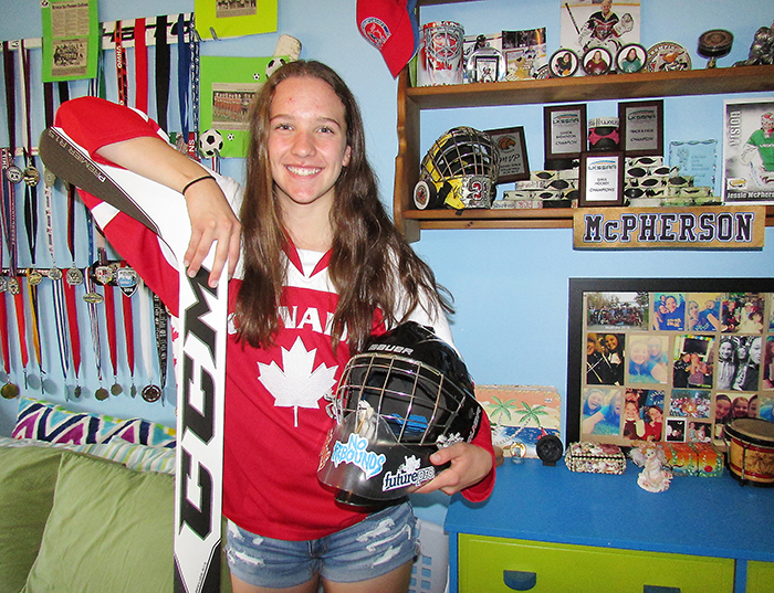 Jessie McPherson shows off the trophies and medals she's already earned through hockey by the age of 14. McPherson is off to play in the Provincial Women's Hockey League for the Cambridge Rivulettes in the fall.