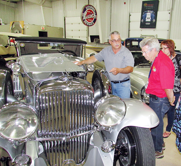 Ernie Morreau of RM Classic Cars showcases a vintage Duesenberg to members of the Canadian Coasters, including George Windsor of Prince George, B.C. The Coasters came through Chatham-Kent July 27 as part of the group's Canadian Coast to Coast Classic Vehicle Tour.