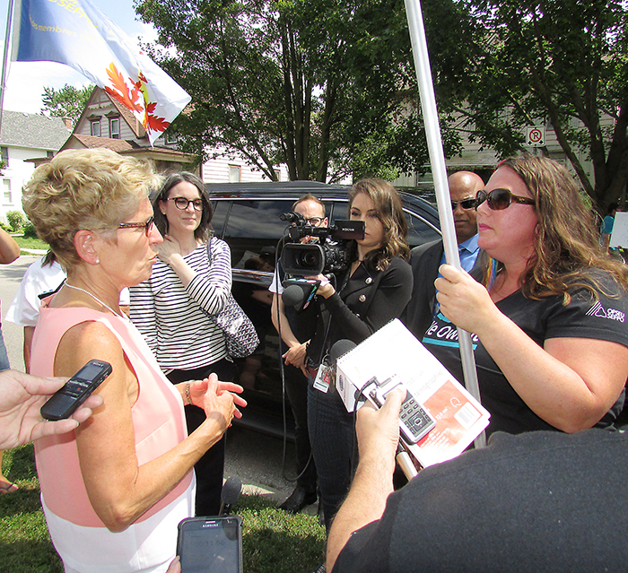 Ontario Premier Kathleen Wynne took a moment Thursday to talk to OPSEU area mobilizer Jordan McGrail about selling off provincial assets such as Hydro One during her afternoon stop in Chatham.