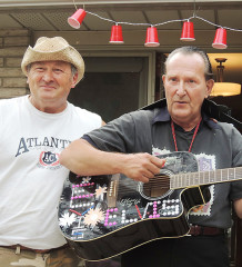 Local Elvis mega-fan Brian Corriveau, right, with his cousin Dale LeGroulx, belts out an Elvis Presley tune. Elvis passed away 40 years ago, on Aug. 16, 1977. Corriveau and LeGroulx have been to Graceland, Elvis' mansion, in Memphis, Tenn.