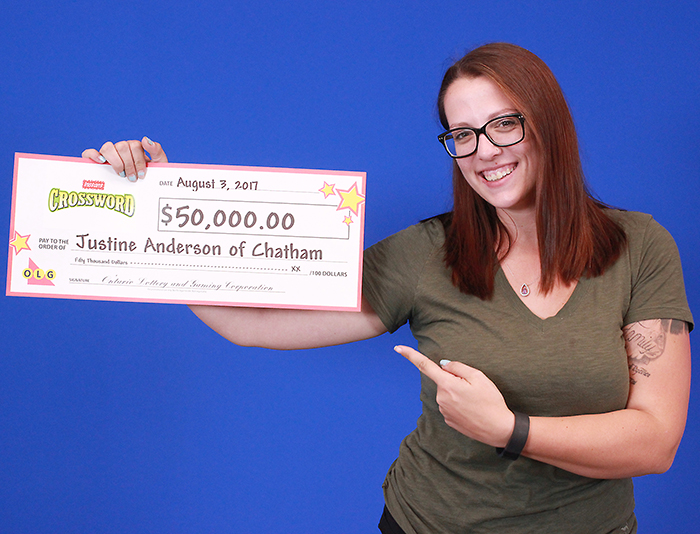 Chatham's Justine Anderson shows off her recent lottery winnings.
