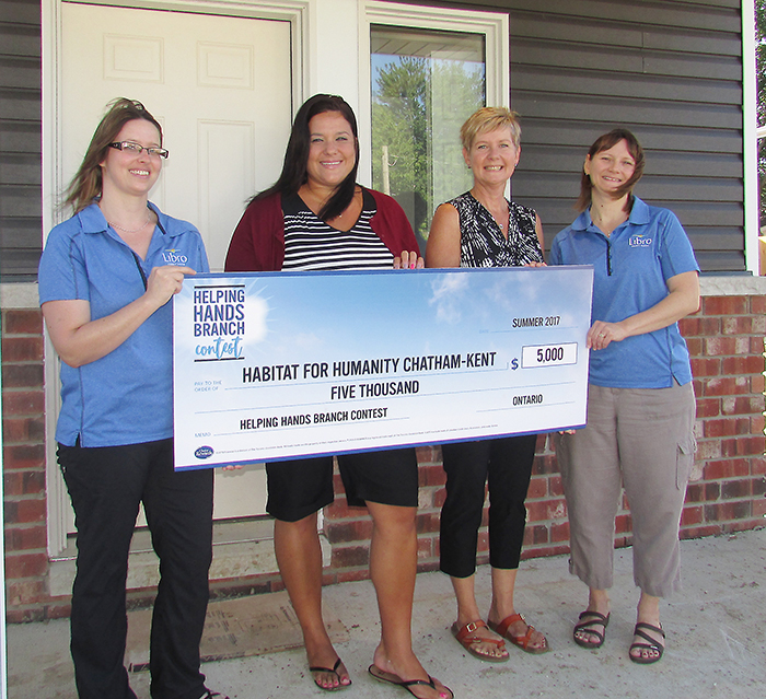 Maddalena Vaughan, left, and Jolene Turner of Libro Credit Union in Blenheim hand a cheque for $5,000 to Habitat for Humanity officials Anne Taylor and Nancy McDowell.