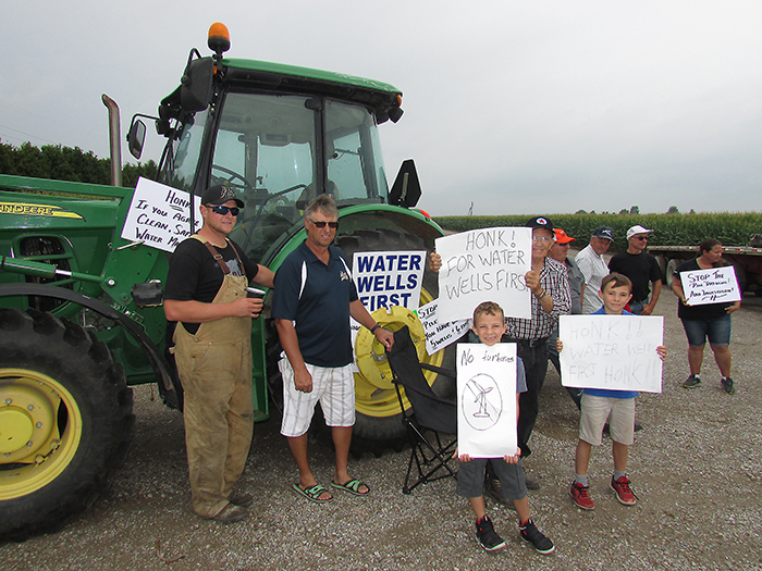 Members of the grassroots activist group Water Wells First showed up at the North Kent Wind Farm construction site on Countryview Line at 6 a.m. this morning to block workers from entering the site. WWF is demanding the halt of all construction for the NKW1 project and that the Ministry of the Environment investigate the contamination of five water wells in the area. WWF put up blockades at three of the five sites currently under construction in north Chatham.