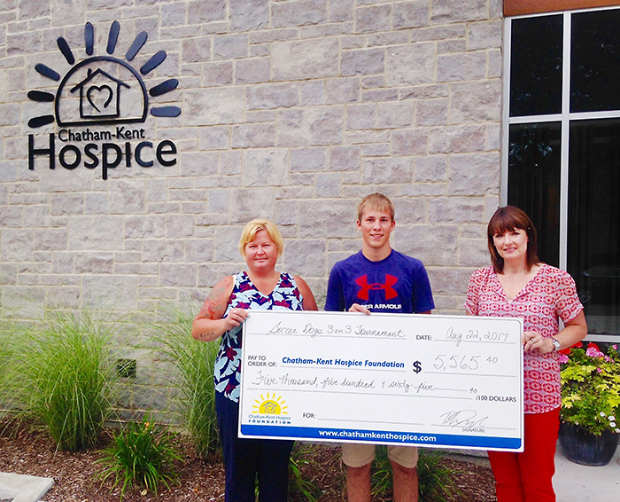 From left, Connie Santavy and Rhys Dulisch present Jodi Maroney, Chatham-Kent Hospice Foundation Executive Director, with the proceeds from this year's Blenheim Soccer Dogs 3 on 3 Tournament.