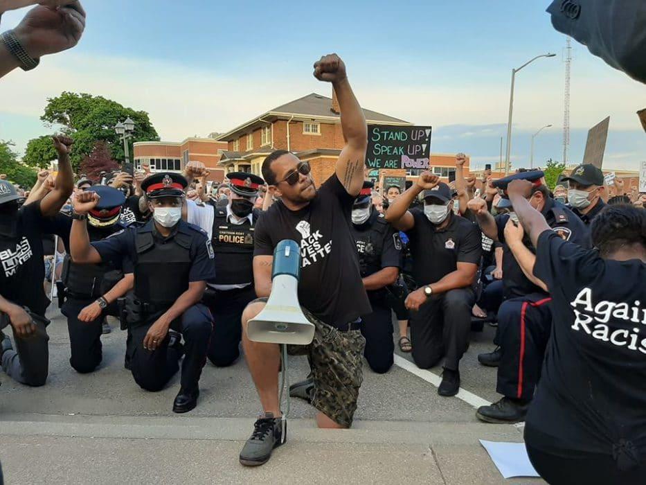 Hundreds march, flag lowered, police take knee for Black Lives ...